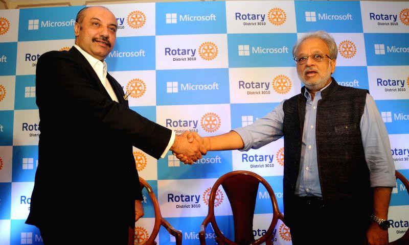 Microsoft Corporation (India) Managing Director Karan Bajwa (L) shakes hand with District Governor of Rotary International District 3010 Sanjay Khanna during the signing of a Memorandum of ... - Sanjay Khanna
