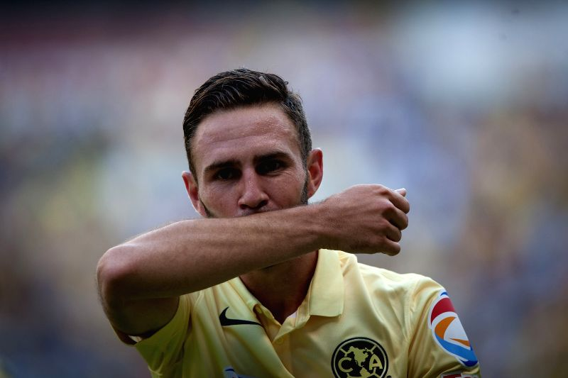 :Miguel Layun of America celebrates after scoring during the Liga MX soccer match of the Opening Tournament 2014, against Pachuca, held at Azteca Stadium, in ...
