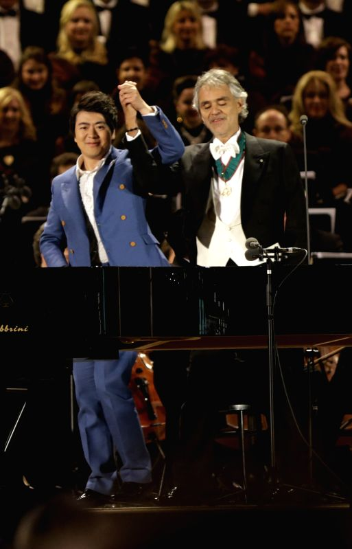 Italian tenor Andrea Bocelli(R) and Chinese pianist Lang Lang perform during the opening ceremony of 2015 Milan Expo, in Milan, Italy, April 30, 2015. The Milan Expo ...