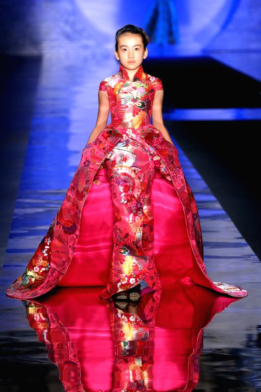 MILAN, July 14, 2015A young model presents a creation by Chinese ...