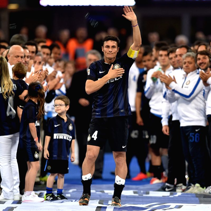 Inter Milan's Javier Zanetti greets audience after the Italian Serie A soccer match against Lazio in Milan, Italy, May 10, 2014. Inter Milan won 4-1.