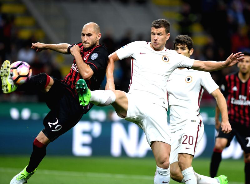 MILAN, May 8, 2017 - Edin Dzeko(R) of Roma vies with Gabriel Paletta of AC Milan during the Italian Serie A soccer match between AC Milan and Roma in Milan, Italy, on May 7, 2017. Roma won 4-1.