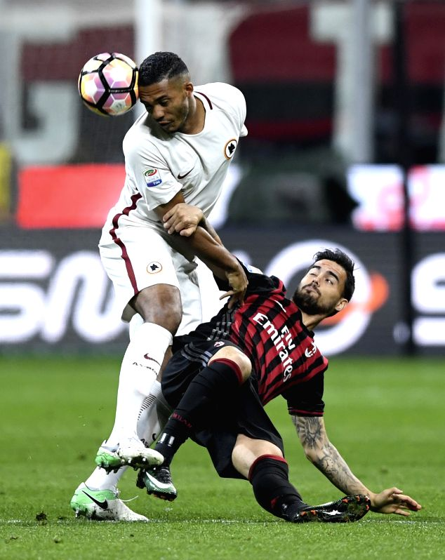 MILAN, May 8, 2017 - Juan Jesus(L) of Roma vies with Jose Sosa of AC Milan during the Italian Serie A soccer match between AC Milan and Roma in Milan, Italy, on May 7, 2017. Roma won 4-1.