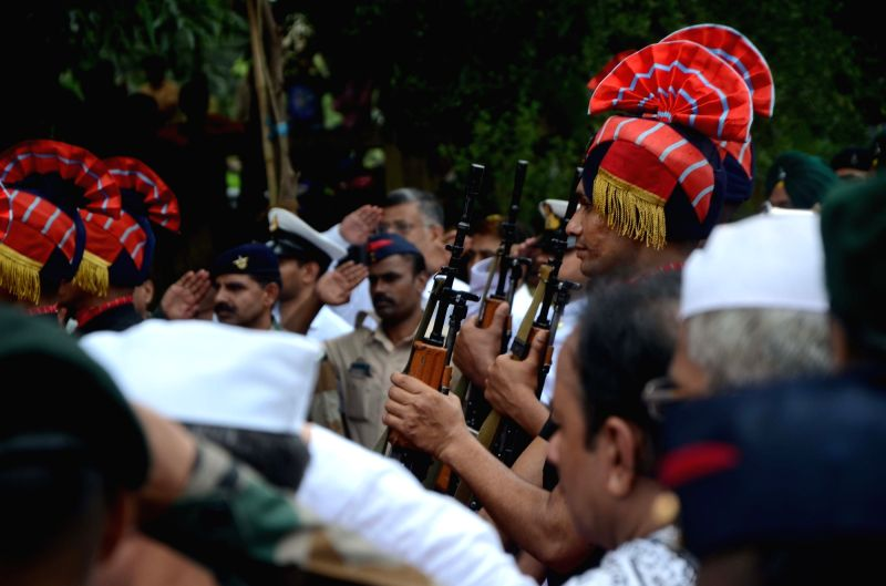 Military band pays homage to Major Kaustubh P. Rane ahead of his last rights, in Maharashtra's Thane on Aug 9, 2018. Thousands of people, including grieving family members, bid a tearful ...