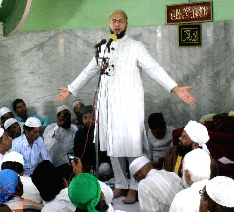 MIM President Asaduddain Owaisi addresses during Jalsa-e-Youm-ul-Quraan at Quthbullapur in Hyderabad on June 26, 2015.