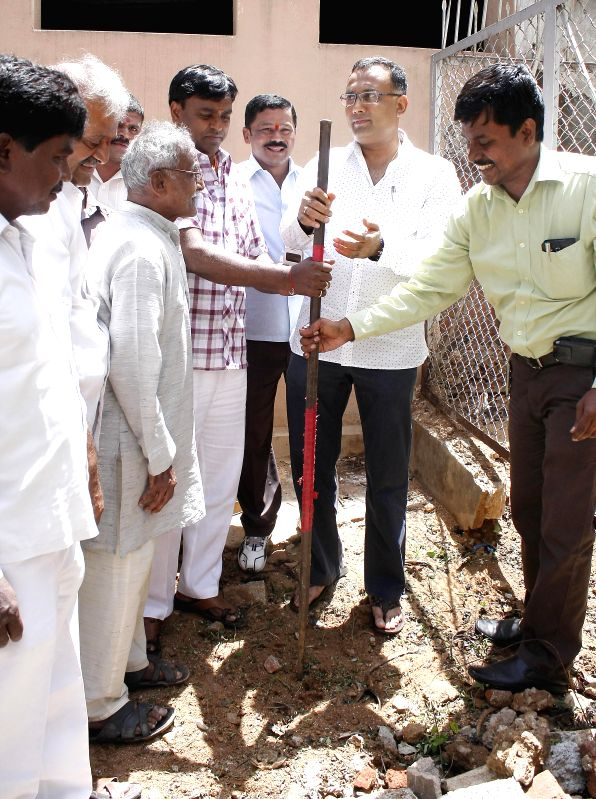 Minister Dinesh Gundurao inaugurates various developments works in Sehsadripuram ward, in Bangalore on June 16, 2014.