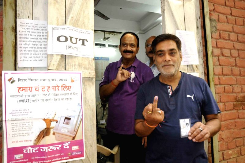 Minister of State for Drinking Water and Sanitation Ram Kripal Yadav show his finger marked with phosphorous ink after casting his vote during the third phase of Bihar assembly polls in Patna ...