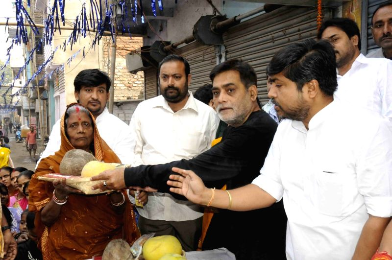 Minister of State for Drinking Water and Sanitation Ram Kripal Yadav distribute Chhath Puja items to the devotees on the occasion Nahai Khai (1st day of Chhath Puja) in Patna on Nov 15, 2015. - Ram Kripal Yadav
