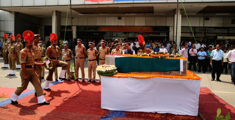Minister of State for Home Affairs Kiren Rijiju pays tributes to the martyred BSF Head Constable Prem Sagar in New Delhi on May 2, 2017. Also seen Border Security Force Director General KK ...