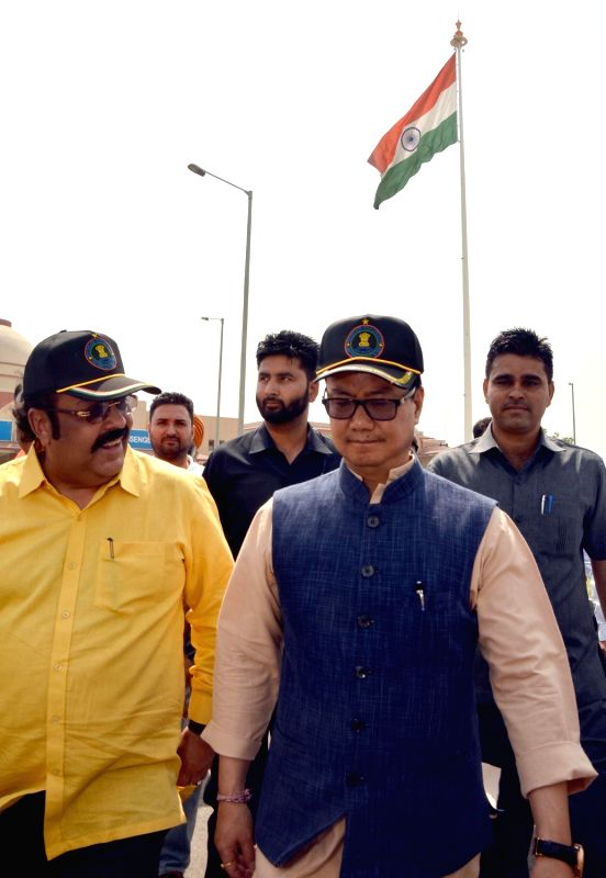 Minister of State for Home Affairs Kiren Rijiju with MP Shwait Malik during the inauguration of monumental a giant national tri-colour flag on a 107 foot flagpole at The Integrated Check Post ... - Malik