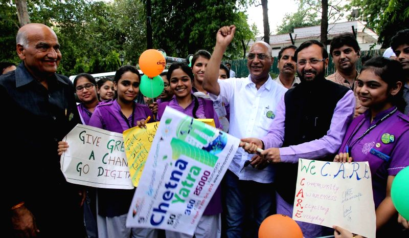 Minister of State for Information and Broadcasting (Independent Charge), Environment, Forest and Climate Change (Independent Charge) and Parliamentary Affairs Prakash Javadekar flags-off `chetna ...
