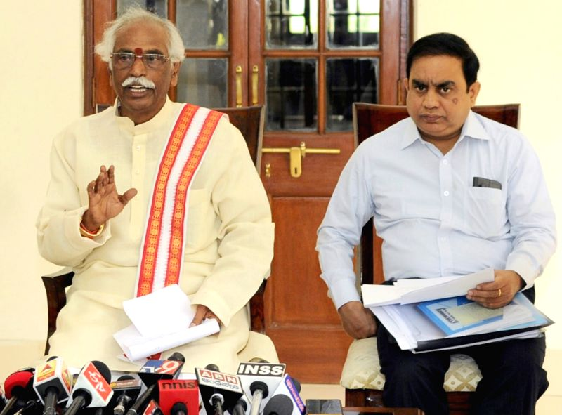 Minister of State for Labour and Employment (Independent Charge) Bandaru Dattatreya (R) a press conference in New Delhi on April 29, 2017.