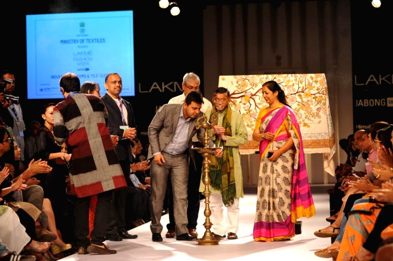 Minister of State for Ministry of Textiles Santosh Gangwar with Indian Administrative Service officer of Rajasthan Kiran Soni Gupta during the Lakme Fashion Week (LFW) Winter/ Festive 2014 in Mumbai,