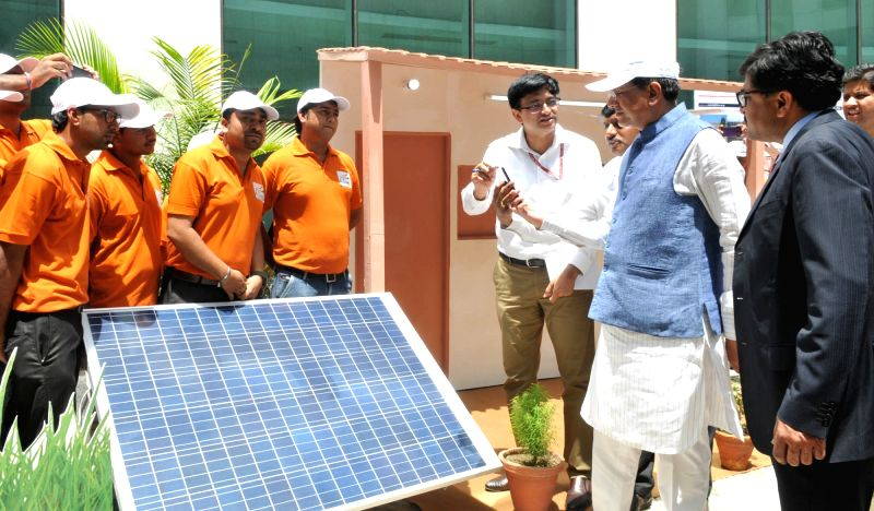 Minister of State for Power, Coal, New and Renewable Energy and Mines (Independent Charge) Piyush Goyal visits the exhibition on Solar Installations and rural electrification initiatives ...