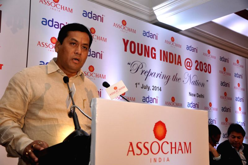 Minister of State for Youth Affairs and Sports (Independent Charge) Sarbananda Sonowal addresses during `ASSOCHAM Young India @ 2030 Conclave: Preparing the Nation` in New Delhi on July 1, 2014.