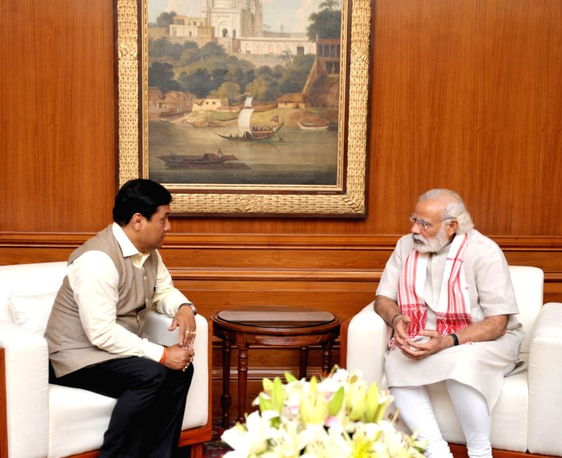 Minister of State for Youth Affairs and Sports (Independent Charge) Sarbananda Sonowal calls on the Prime Minister Narendra Modi, in New Delhi on May 21, 2016. - Narendra Modi