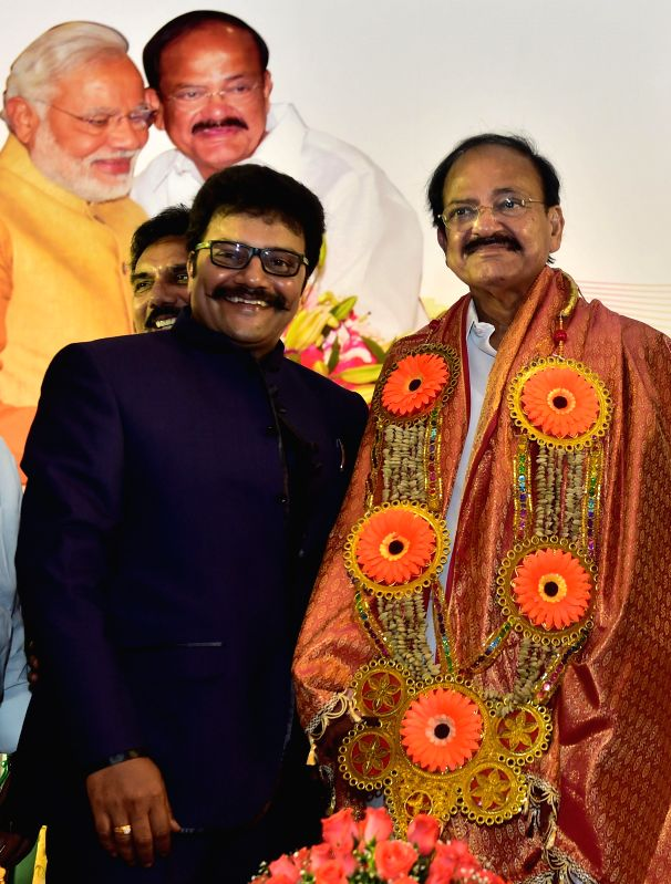 Minister of Urban Development Venkaiah Naidu being felicitated by members from Telugu Association in Chennai on June 21, 2014. - Development Venkaiah Naidu