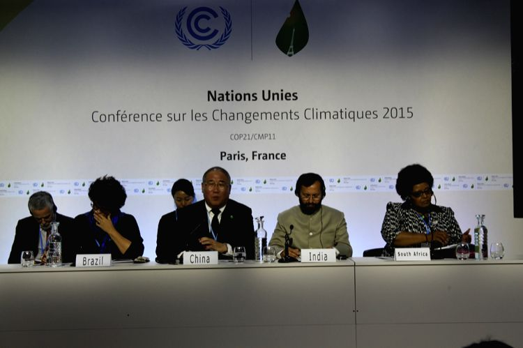 Ministers of four countries BASIC group addresses the media at CoP21. Seated from Left to Right are Izabella Teixeria, minister for the environment of Brazil, Xie Zhenhua, Special Representative for ...