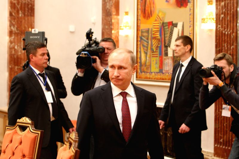 Russian President Vladimir Putin (C, front) arrives for the four-way peace talks on the Ukraine crisis in Minsk, Belarus, on Feb. 11, 2015. Four-way peace talks on ...