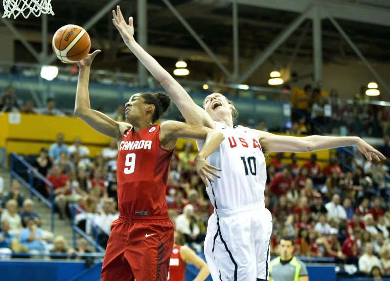 Miranda Ayim(L) of Canada fights for the ball with Breanna Stewart of the United States during their women's final match of the basketball event at the 17th Pan ...