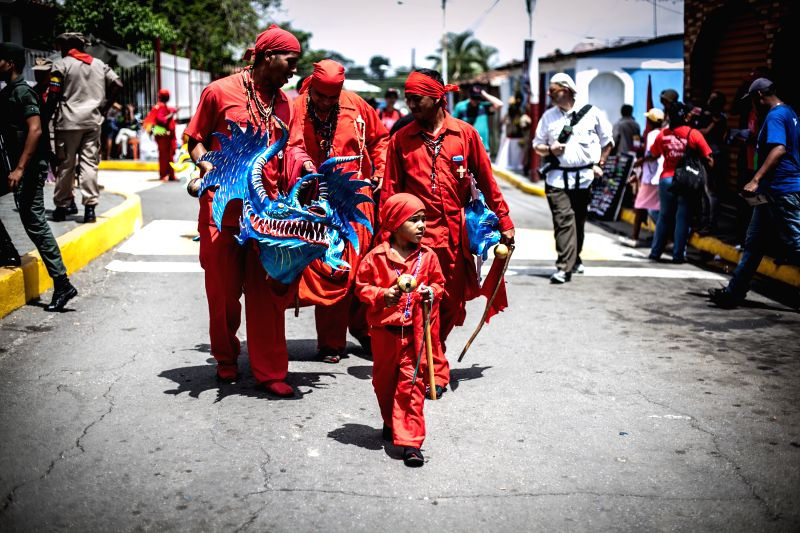 People take part in the catholic celebration of Corpus Christi in San Francisco of Yare, capital of the Simon Bolivar municipality, in the state of Miranda, ...
