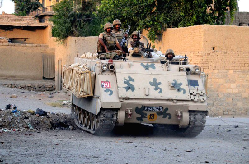 Photo released by Pakistan's Inter Services Public Relations (ISPR) on July 1, 2014 shows Pakistani soldiers riding an armored vehicle during a military operation .