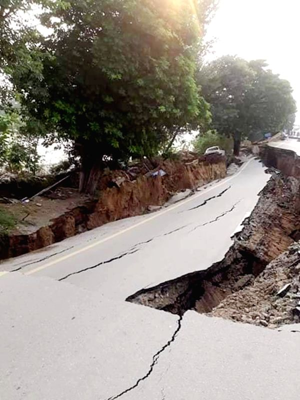MIRPUR, Sept. 24, 2019 (Xinhua) -- Photo taken with a mobile phone shows a damaged road at the earthquake-hit area in Mirpur district of Pakistan-controlled Kashmir on Sept. 24, 2019. A 5.8-magnitude earthquake hit parts of Pakistan on Tuesday. (Str/