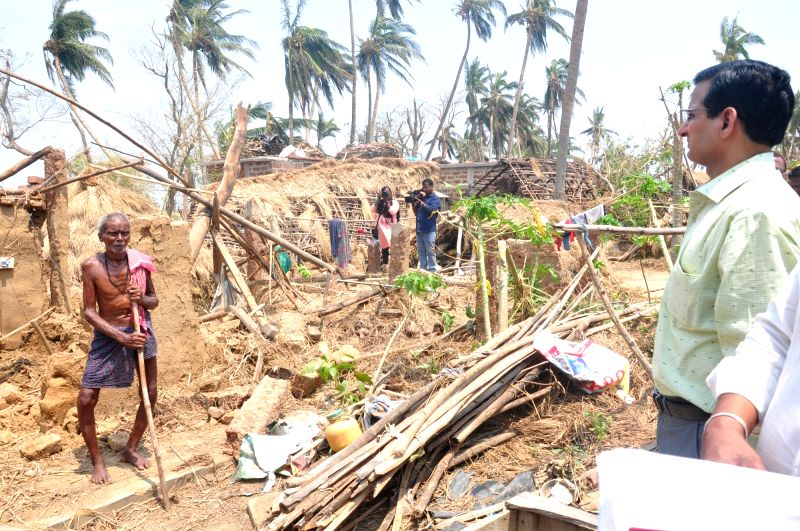 Mirzapur: An official of the nine-member central team takes stock of the damage caused by Cyclone Fani during his visit to the cyclone affected areas of Mirzapur village in Rasulpur Tehsil of Odisha's Jajapur district on May 14, 2019.