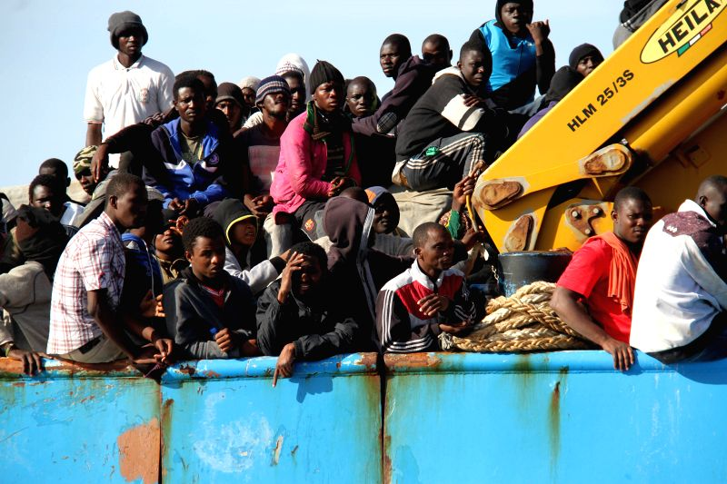A Libyan coastguard boat carrying mostly African illegal migrants arrives at the port in the city of Misrata, Libya, on May 3, 2015, after the coastguard intercepted ...
