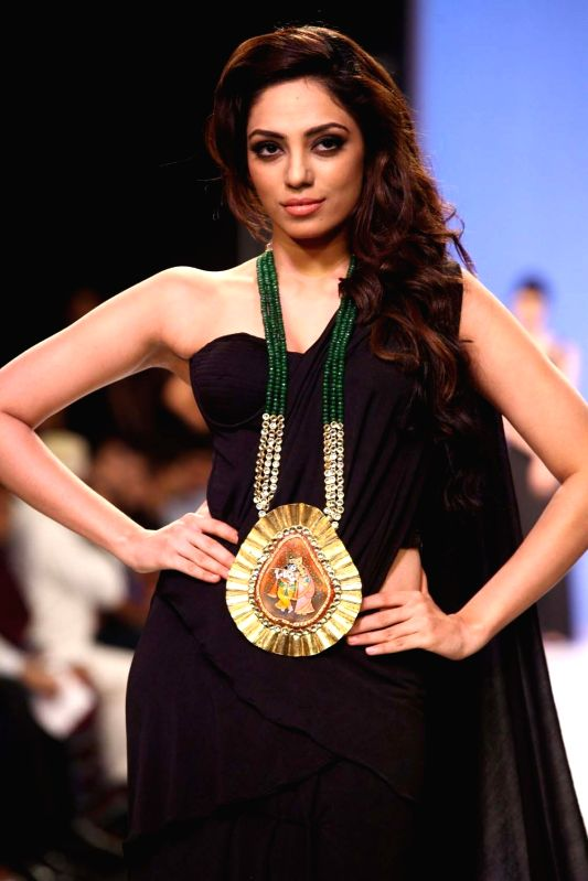 Miss India Earth Sobhita Dhulipala walks the ramp displaying jewellery during the Derewala IIGJ show at the India International Jewellery Week (IIJW) in Mumbai on August 5, 2013.