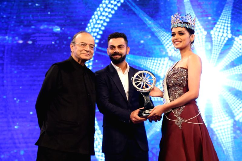 Miss World 2017 Manushi Chhillar during Indian of the Year 2017 award ceremony hosted by CNN News 18 in New Delhi, on Nov 30, 2017. Special Achievement award goes to Manushi Chhillar. Also ... - Virat Kohli and Arun Jaitley