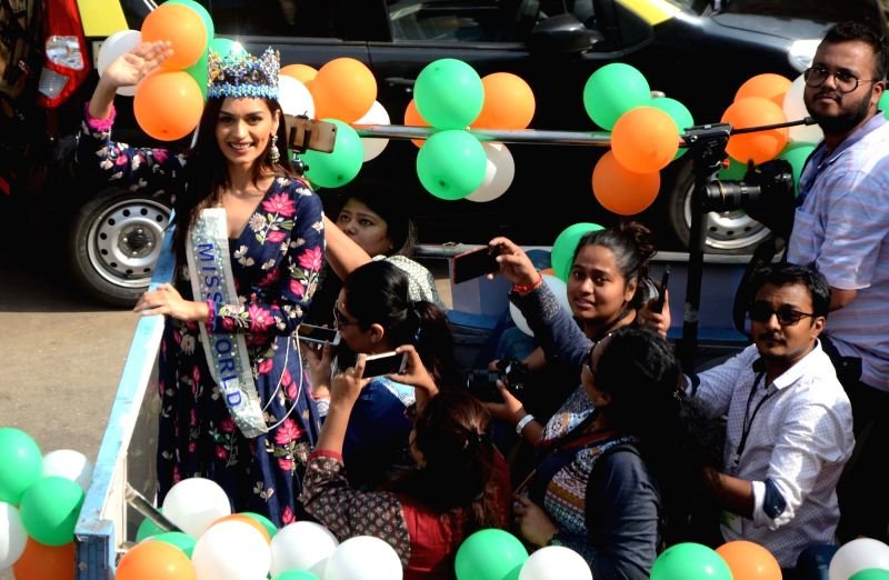 Miss World 2017 Manushi Chillar along with school students during a roadshow in Mumbai on Dec 2, 2017.