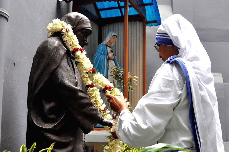 Missionaries of Charity Superior General Sister Mary Prema pays tribute to Mother Teresa on her 104th birth anniversary at the Mother House in Kolkata on Aug 26, 2014.