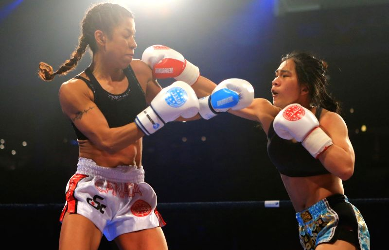 MISSISSAUGA, May 17, 2017 - Huang Li (R) of China fights against Christina Best of Canada during the women's 56kg match of the 1st Annual Wu Lin Feng East-West Kickboxing Battle Series 2017 at ...