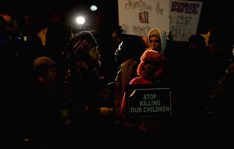 Missouri (United States): Demonstrators attend a protest outside Ferguson police station, St. Louis County, Missouri, the United States of America, Nov. 25, 2014. More than 1,500 National Guard ...