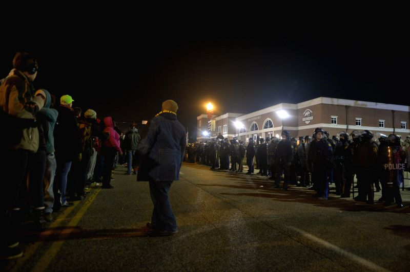 Missouri (United States): Members of National Guard in riot gear stand at the demonstration site outside Ferguson police station, St. Louis County, Missouri, the United States of America, Nov. 25, ...
