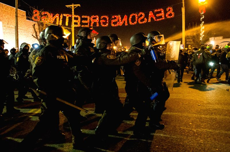 Missouri (United States): Police use pepper spray on protesters in front of the Ferguson Police Department, Missouri, the United States of America, on Nov, 25, 2014. Violence erupted Monday night in .