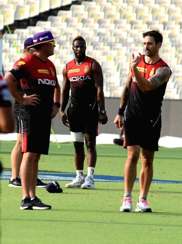 Mitchell Johnson, Andre Russell and Jacques Kallis (coach) of Kolkata Knight Riders (KKR) during a practice session at Eden Gardens in Kolkata, on April 13, 2018.