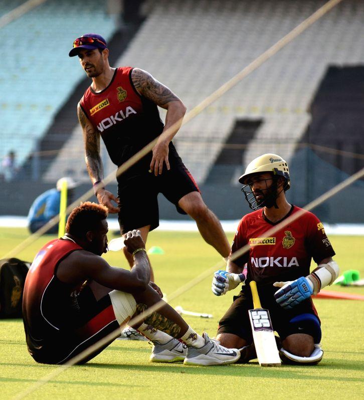 Mitchell Johnson, Dinesh Karthik and Kuldeep Yadav during a practice session at Eden Gardens in Kolkata, on April 13, 2018. - Kuldeep Yadav