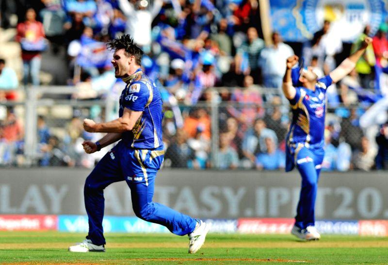 Mitchell McClenaghan of Mumbai Indians celebrate fall of Virat Kohli's wicket during an IPL 2017 match between Mumbai Indians and Royal Challengers Bangalore at at Wankhede Stadium in Mumbai ... - Virat Kohli