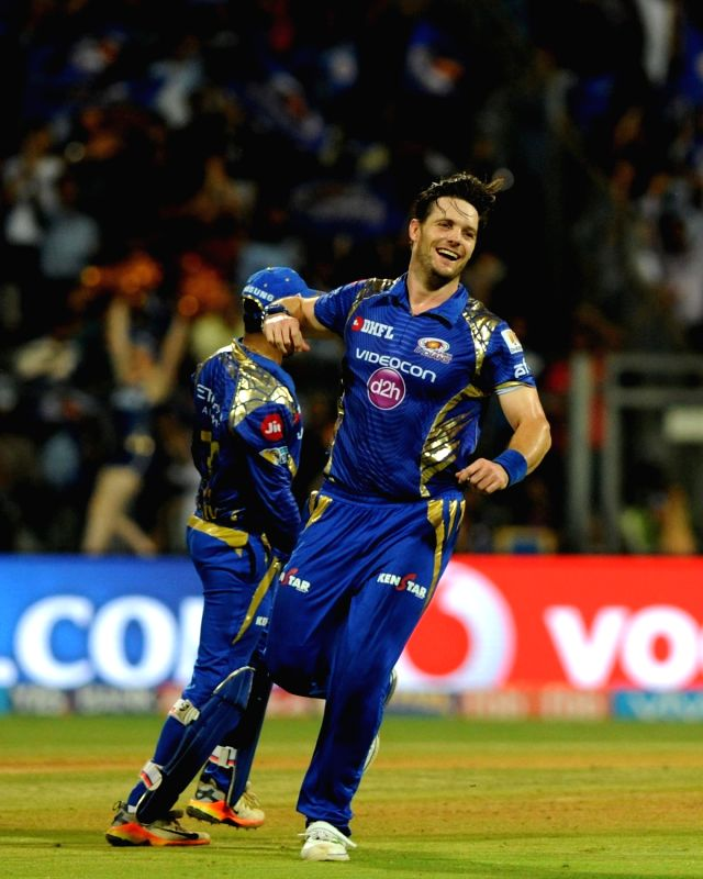 Mitchell McClenaghan of Mumbai Indians celebrates fall of Rahul Tripathi's wicket during the first qualifier of IPL 2017 between Mumbai Indians and Rising Pune Supergiant at Wankhede Stadium ... - Rahul Tripathi