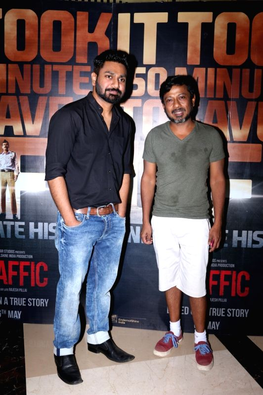 Mithoon and Onir during the screening of film Traffic in Mumbai on May 5, 2016.