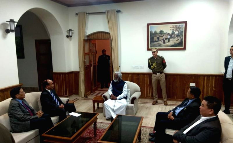 Mizo National Front (MNF) chief Zoramthanga meets Mizoram Governor Kummanam Rajasekharan to stake claim to form government in Mizoram after the party swept the state assembly elections, at ...
