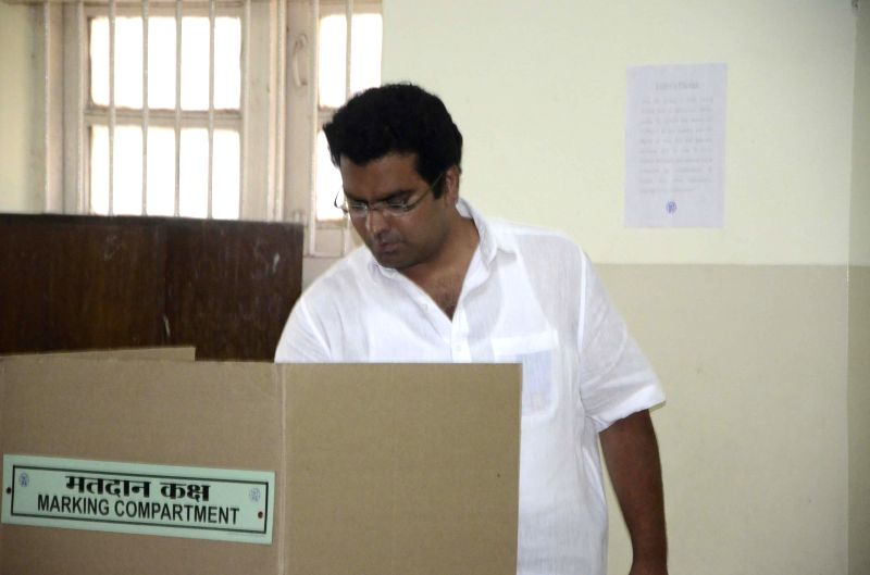 MNS candidate for 2014 Lok Sabha Election from South Central Mumbai Aditya Shirodkar casts his vote at a polling booth in Mahim of Mumbai on April 24, 2014.