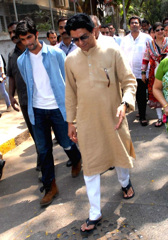 MNS chief Raj Thackeray arrives to cast his vote at a polling booth during the sixth phase of 2014 Lok Sabha Polls in Mumbai on April 24, 2014.