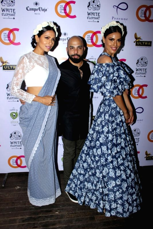 Model Candice Pinto, Fashion designer Mayyur Girotra and Dipti Gujral during the launch of fashion designer Mayyur Girotra's exclusive pret line White Elephant in Mumbai, on May 30, 2017. - Candice Pinto