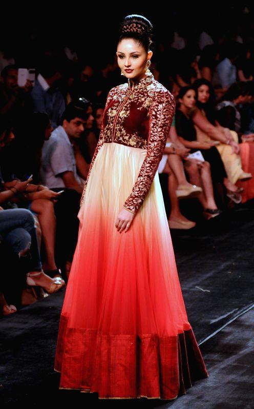 Model displays the creation of fashion designer Vikram Phadnis during the Lakme Fashion Week (LFW) Winter/ Festive 2014, in Mumbai, on Aug. 23, 2014.