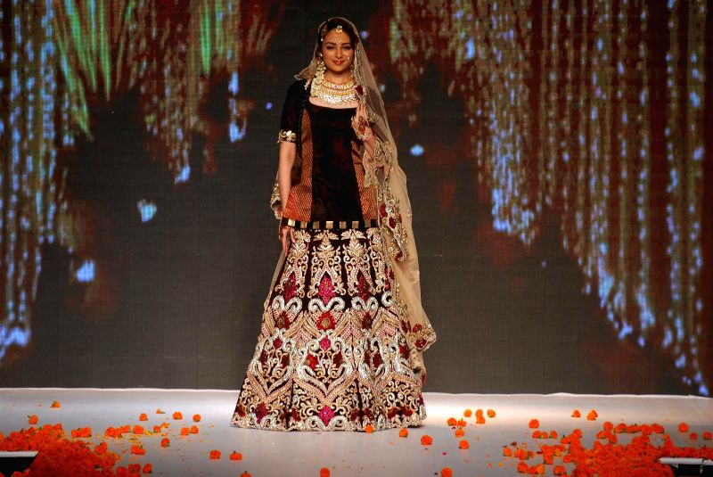 Model displays the creations of fashion designer Archana Kochhar during the India International Jewellery Week (IIJW) in Mumbai, on July 15, 2014.