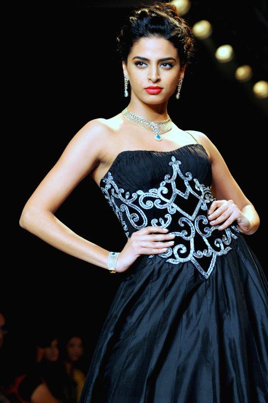 Model displays the creations of P N Gadgil Jewellers during the India International Jewellery Week (IIJW) in Mumbai, on July 15, 2014.