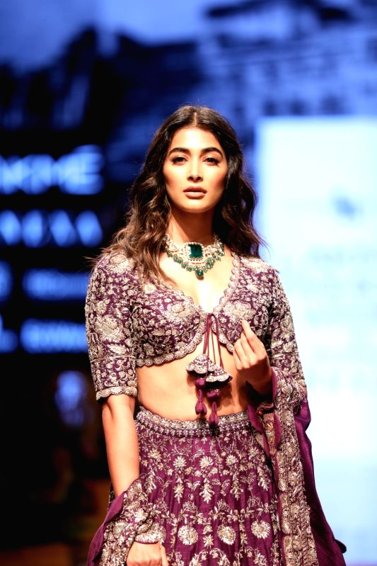 Model Pooja Hegde showcases creations of fashion designer Jayanti Reddy at the Lakme Fashion Week Winter/Festive 2019 in Mumbai on Aug 23, 2019.